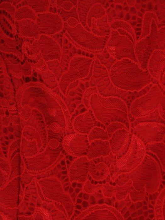 Asymetryczna kreacja wizytowa Tomera II, elegancka kreacja z kokardą.