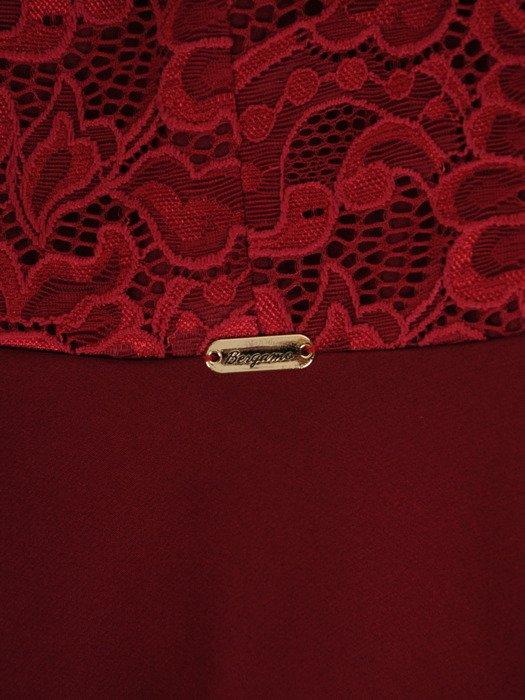 Asymetryczna kreacja wizytowa Tomera III, elegancka kreacja z kokardą.