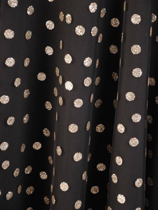 Elegancka sukienka w groszki i ozdobnym wiązaniem na szyi 30804