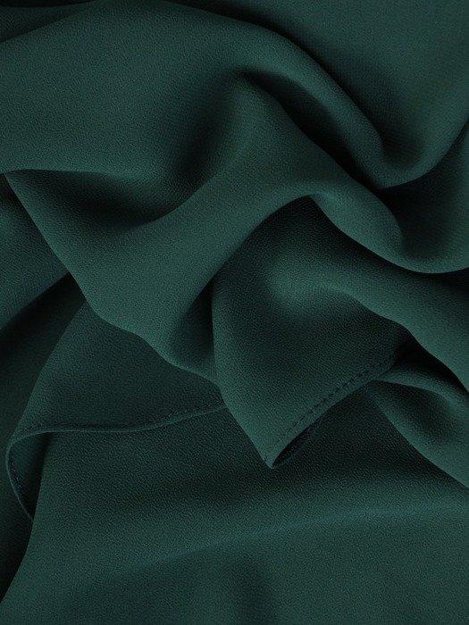 Zielona sukienka z asymetryczną, wyszczuplającą narzutką 23350